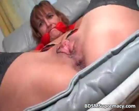 Helpless mature whore spreads legs